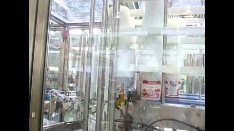 РХМ-3 с автоматической загрузкой тары и с манипулятором для вывода готовой продукции с автомата