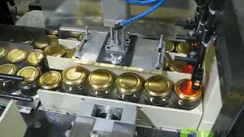 Групповая упаковка банок на термоусадочном автомате