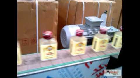 Нанесение термоусадочной этикетки на прямоугольные бутылки